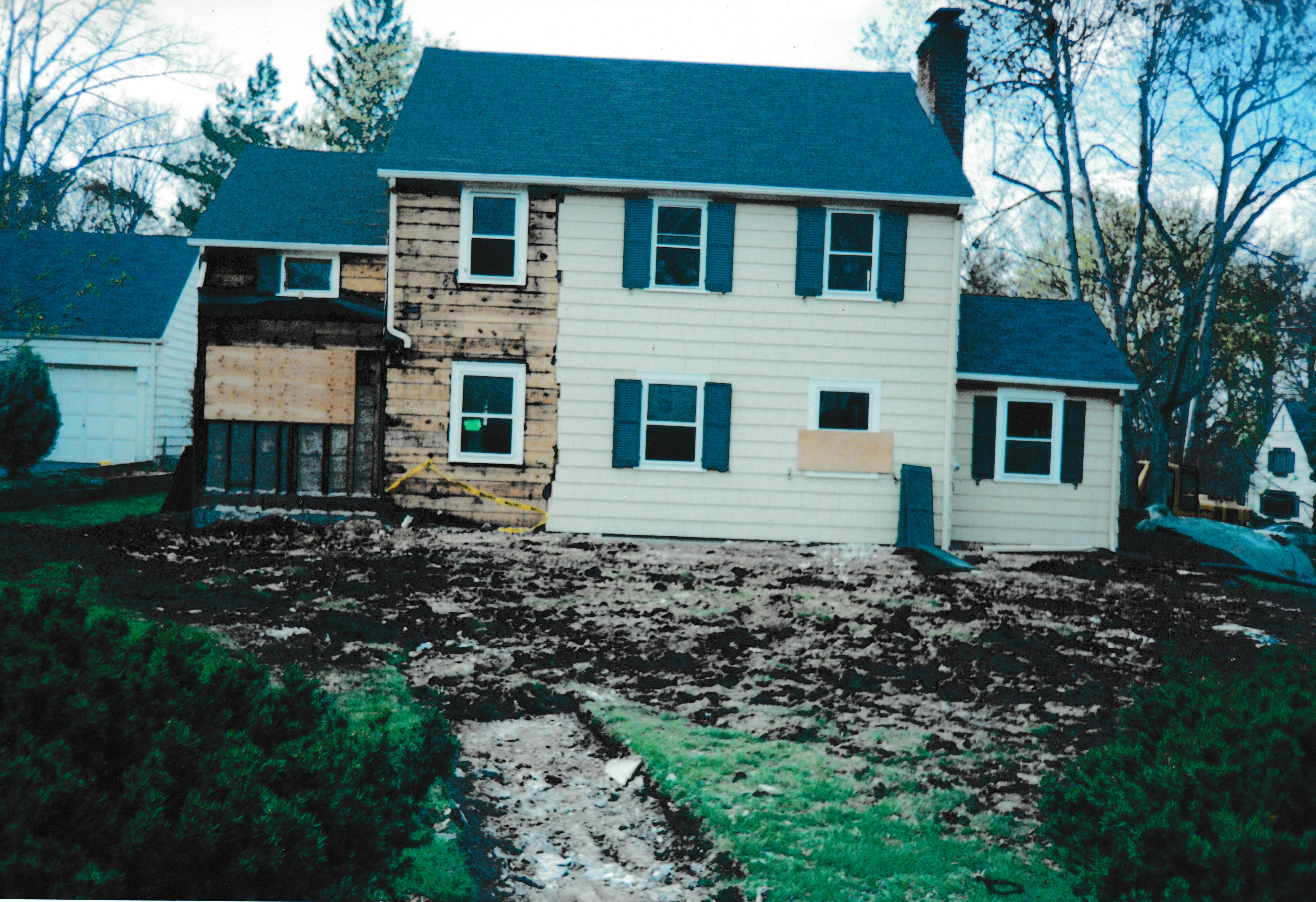 Partially constructed house with torn up lawn in the foreground